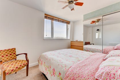 Master bedroom: Double bed, two bedside tables. Extensive views over the roof tops of Paignton.