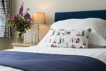 seaside theme pillow on the single bed