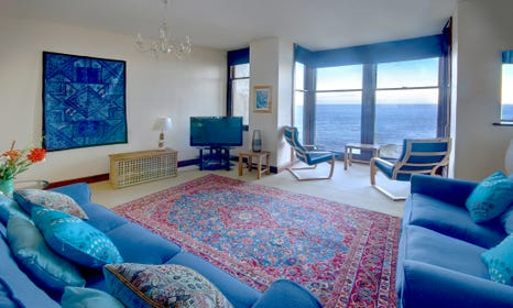 Spacious comfortable sitting room with wonderful sea views
