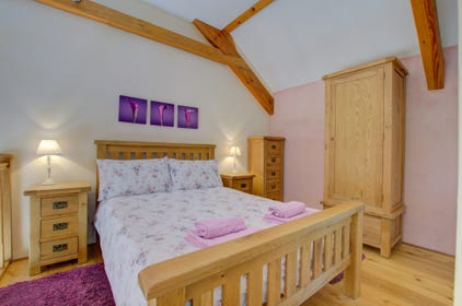 The double bedroom is on the mezzanine floor and has an ensuite shower room, WC and basin