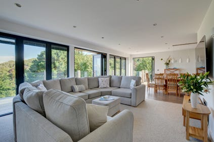 Stunning sitting room with ample seating and huge windows to enjoy the spectacular views