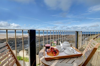 Enjoy breakfast together on the small private balcony overlooking the sea