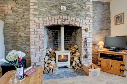 The cosy fireplace at Seaview Cottage, a real benefit on cooler evenings