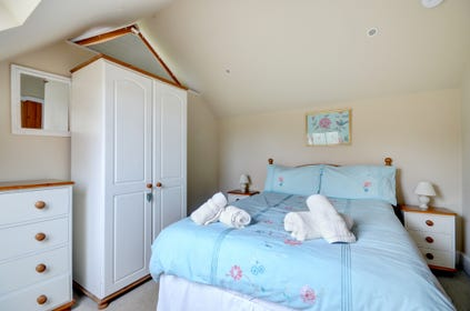 Upstairs double bedroom with sloping ceiling and velux window with magnificent views of the valley
