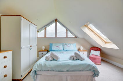 The stylish double bedroom is on the first floor and has wonderful views