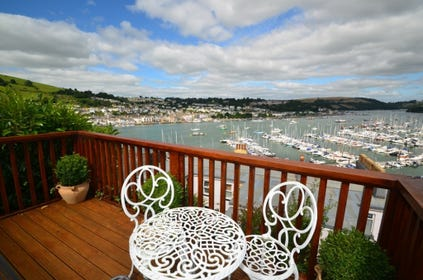 Outside: Lovely furnished deck area with views over the River Dart, the perfect place to unwind after a busy day exploring the area or for relaxing with a coffee over breakfast. The lovely views  extend across the river to Dartmouth and the British Royal