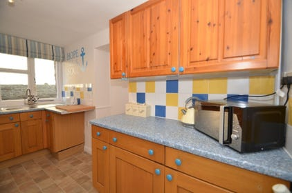 Kitchen: Gas oven and 4 ring hob, a stylish SMEG fridge/freezer, microwave and all other useful kitchen utensils. (Washer/dryer stored away in the dining room.) At the kitchen entrance there is a large storage cupboard under the stairs for shoes, extra co