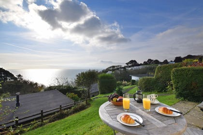 Bistro table in the garden overlooking Start Bay