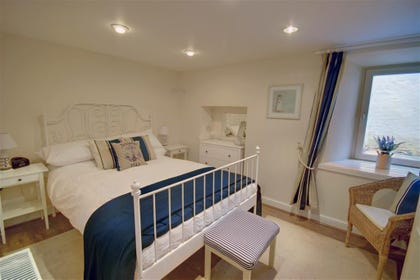 Good quality bed linen and lovely furnishings make this a welcoming bedroom
