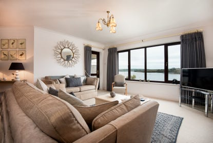 amazing river estuary views from spacious living room, with large bright picture windows