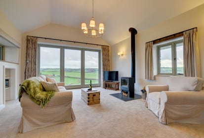 Beautifully decorated sitting room with stunning countryside views