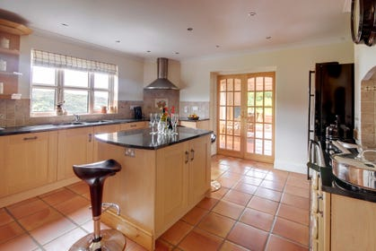 The extensive kitchen/breakfast room is beautifully fitted in light oak complemented by polished granite worktops and terracotta stone tiled floor