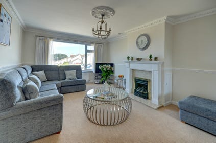 The spacious living room is furnished in a contemporary style and offers every comfort