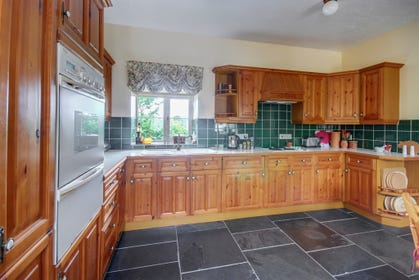 The attractive breakfast kitchen is extremely well equipped