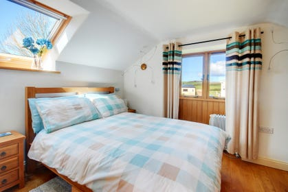 The double bedroom with lovely views is served by a pristine modern shower room