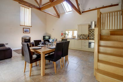 A really spacious open plan living room with superb kitchen area is stylishly furnished