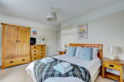 Attractive master bedroom with solid oak furniture