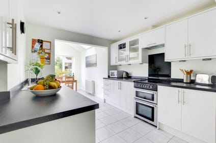 The spacious new kitchen with extended breakfast room opens onto a private, fully enclosed rear garden