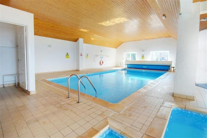 The apartment benefits from a large heated pool and childrens pool.