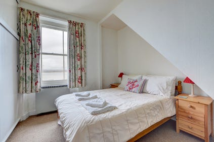 The double bedroom enjoys estuary views