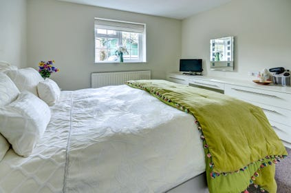 Good sized attractive bedroom with king size bed and fitted wardrobes