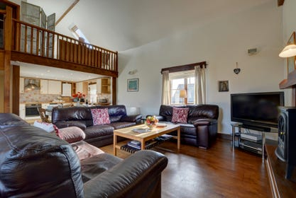 Spacious open plan sitting room, kitchen and dining room with mezzanine floor