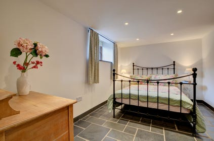 Double bedroom with iron bedstead and ensuite bathroom