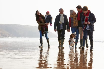 Family on a Devon beach during February half-term