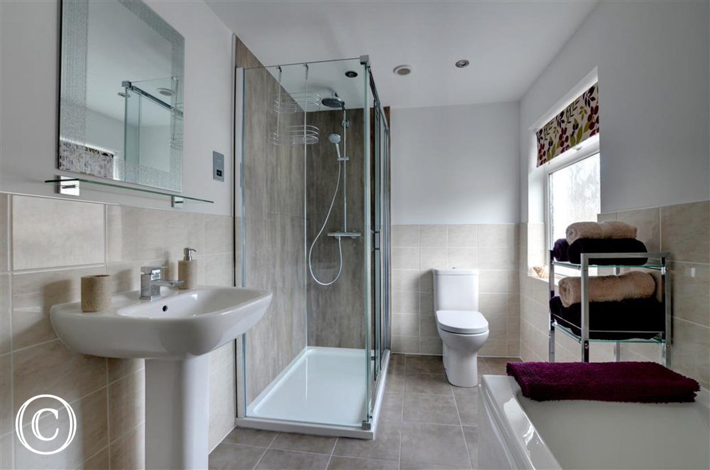 Spacious modern family bathroom with separate shower