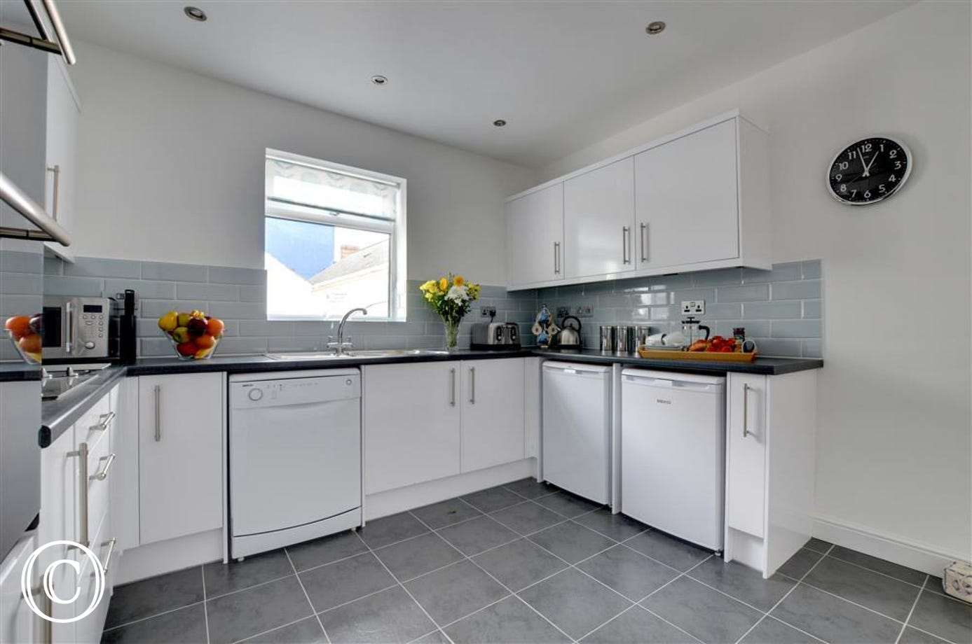 The well equipped kitchen has all you will need for dining in and there is an informal breakfast/games area at the rear