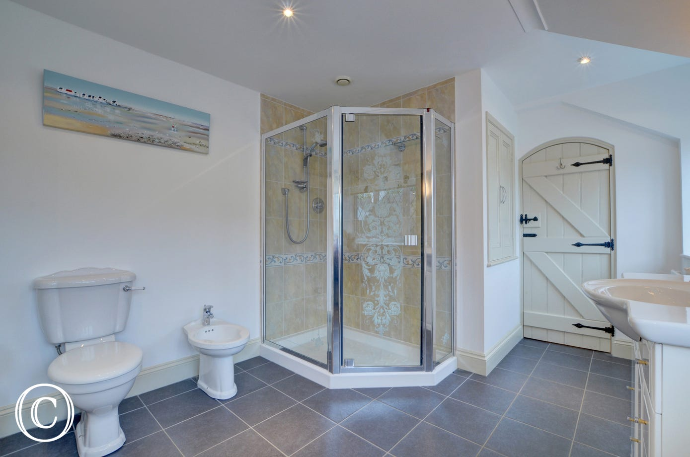 The large en suite bathroom which has a separate shower and bath