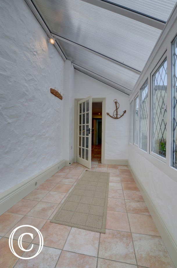 Large porch, ideally for storing muddy or sandy boots!