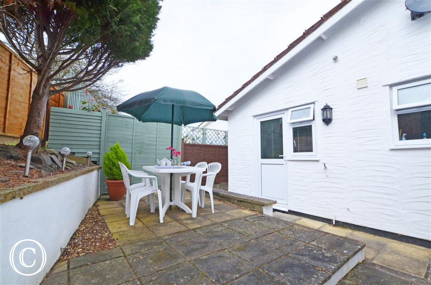 The fully enclosed rear patio and garden is ideal for alfresco dining