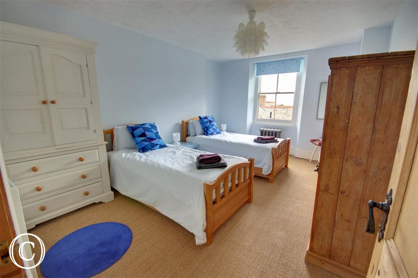 The Twin bedroom is spacious with wonderful sea views.