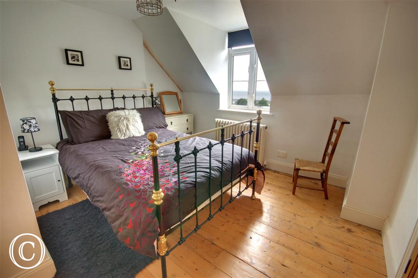 Bedroom 3 with Double iron bedstead is situated on the second floor.