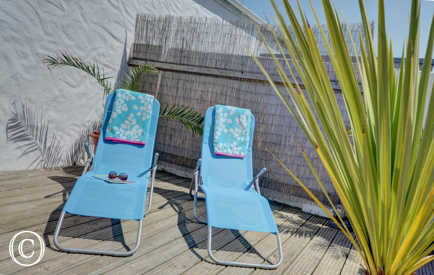 Top up your tan on the comfortable sun loungers!