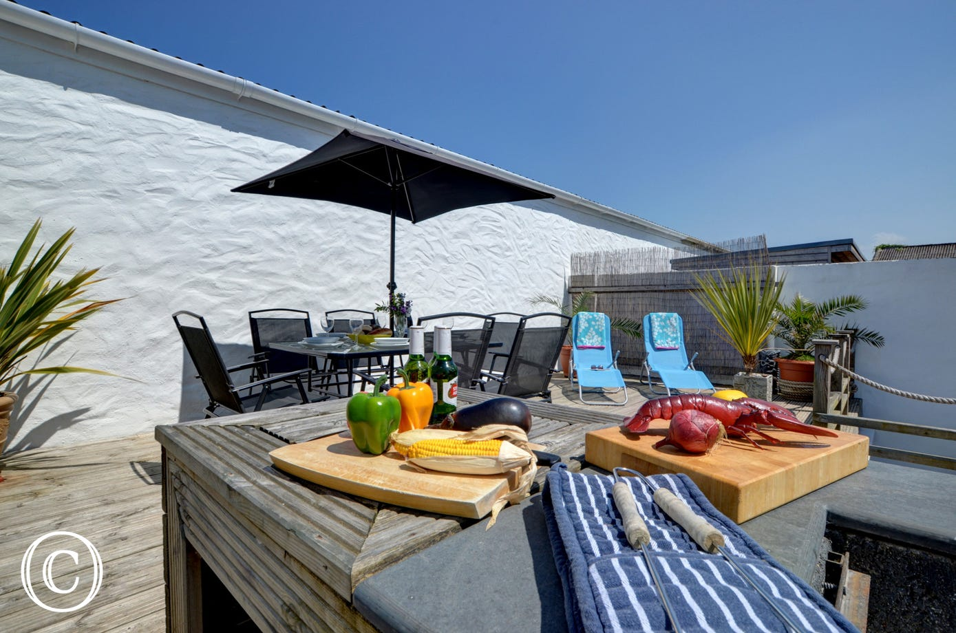 The superb terrace area is perfectly kitted out to enjoy BBQ's and al fresco dining