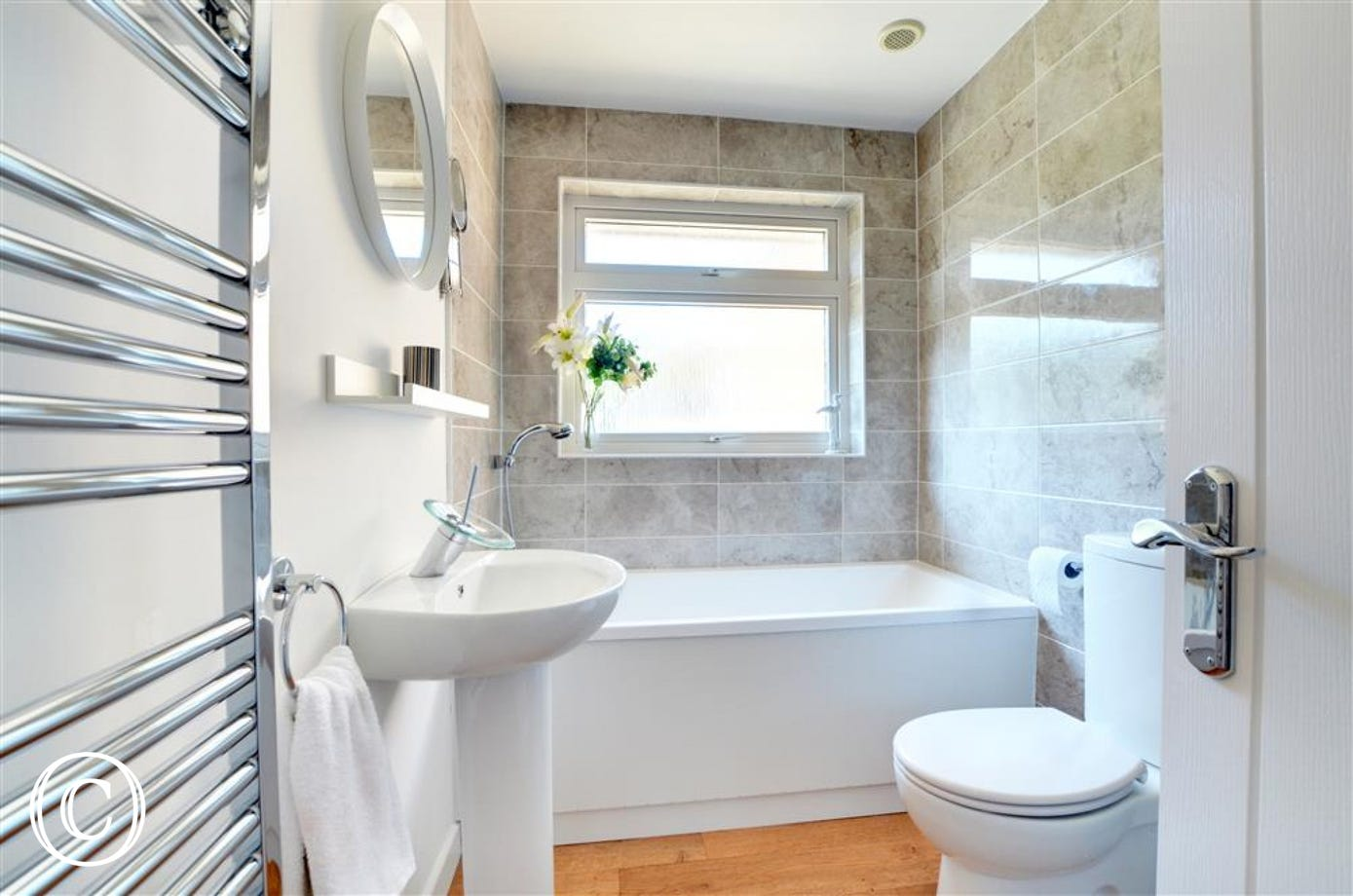 Attractive bathroom with bath and separate shower cubicle