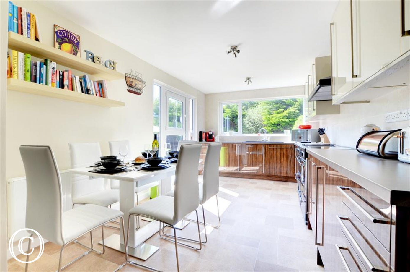 The kitchen area is light, airy and well equipped, including a Tassimo coffee machine