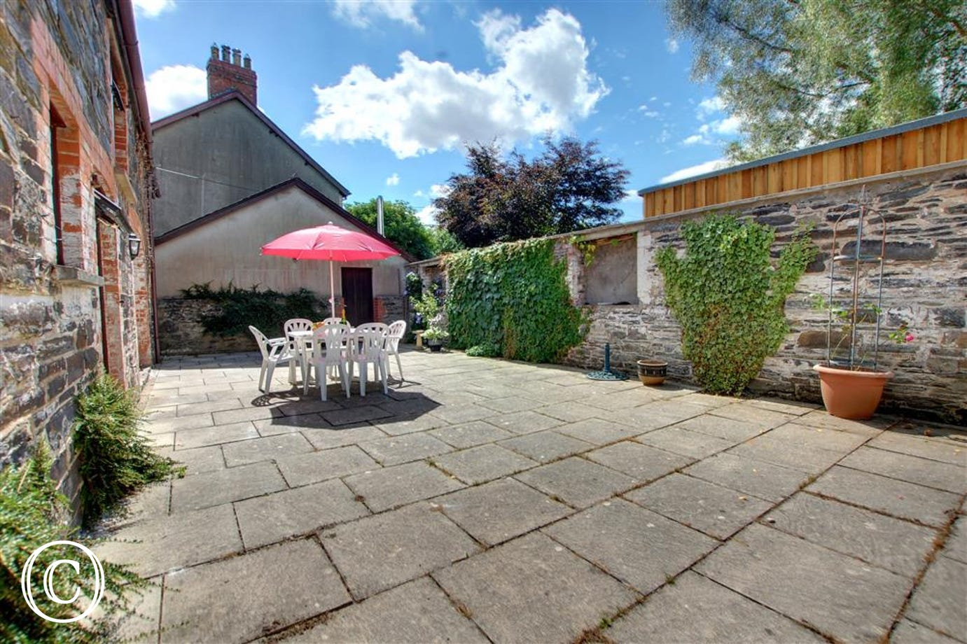 Large and fully enclosed sun trap courtyard ideal for relaxation and al fresco dining