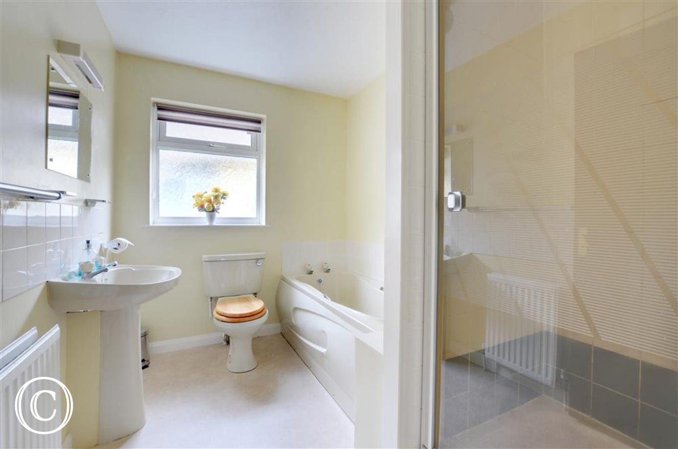Bathroom with separate bath and shower cubicle
