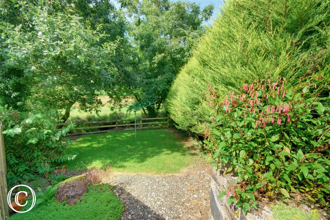 Private lawned and fenced garden