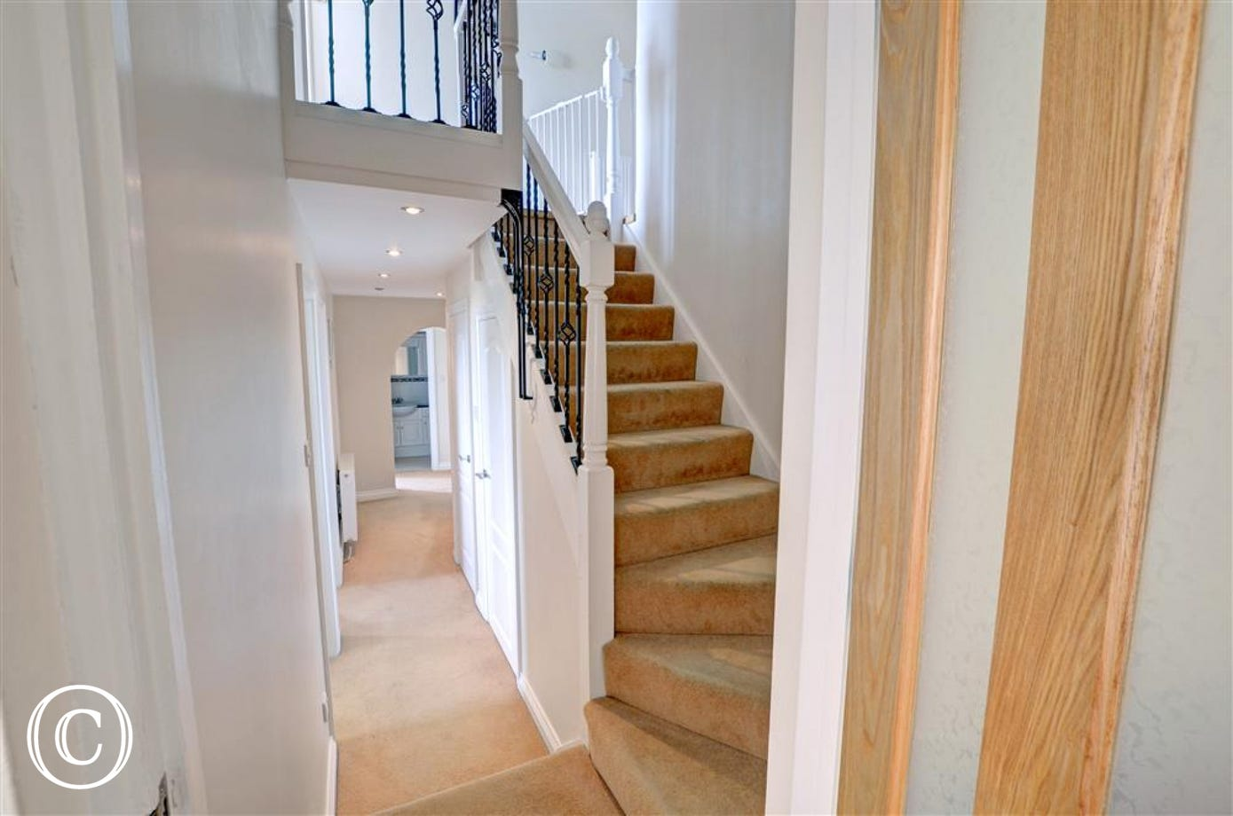 The staircase leads to the 4 downstairs bedrooms
