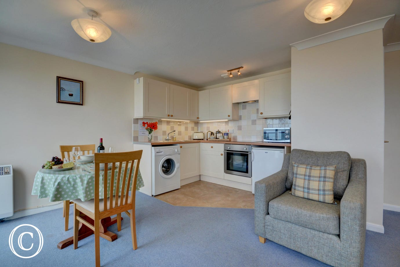 The open plan living area is light and bright and offers wonderful sea views