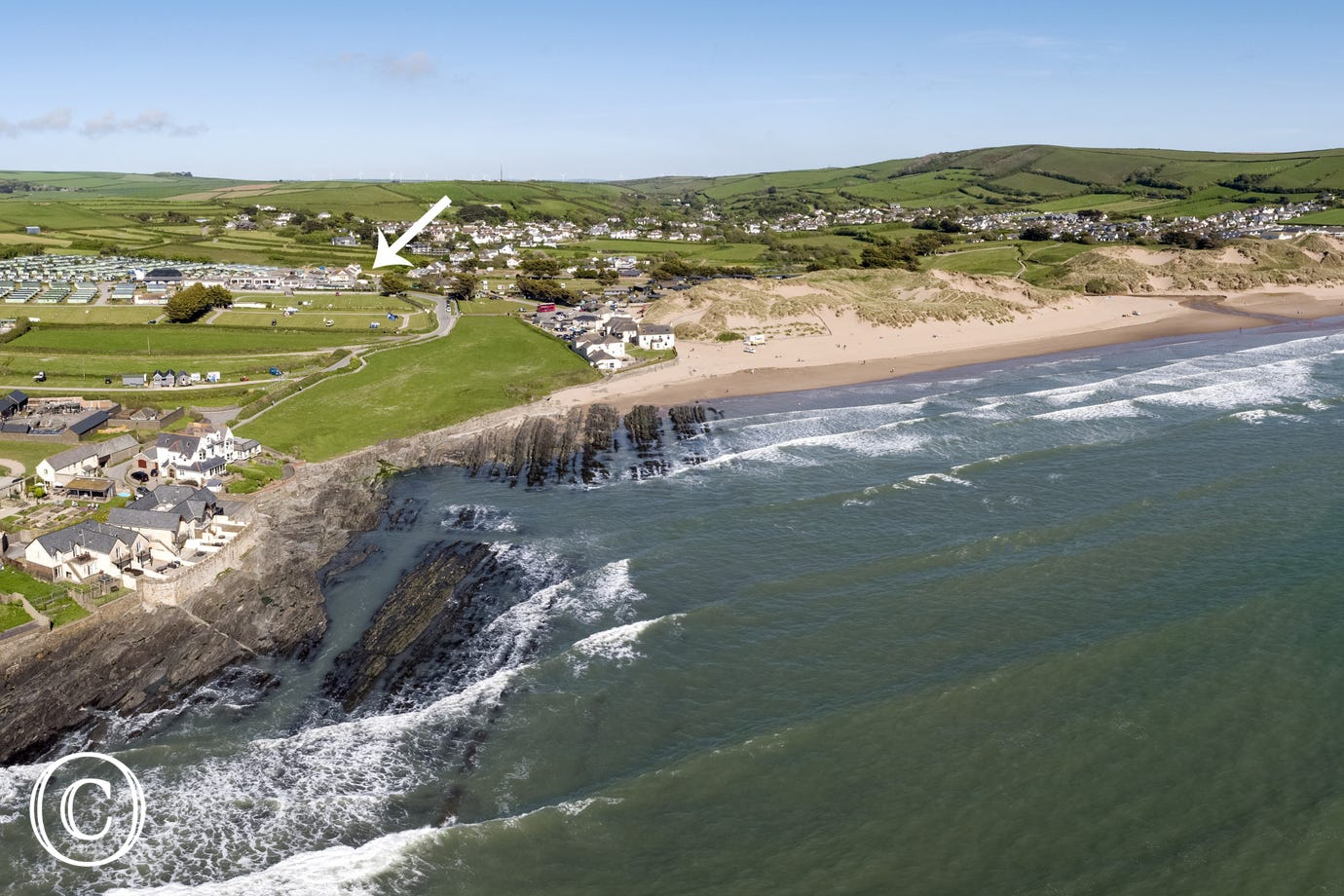 This aerial view shows just how close Beach Cottage is to the beach!