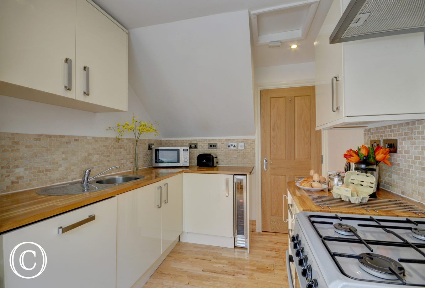 A modern well equipped kitchen provides everything you could need