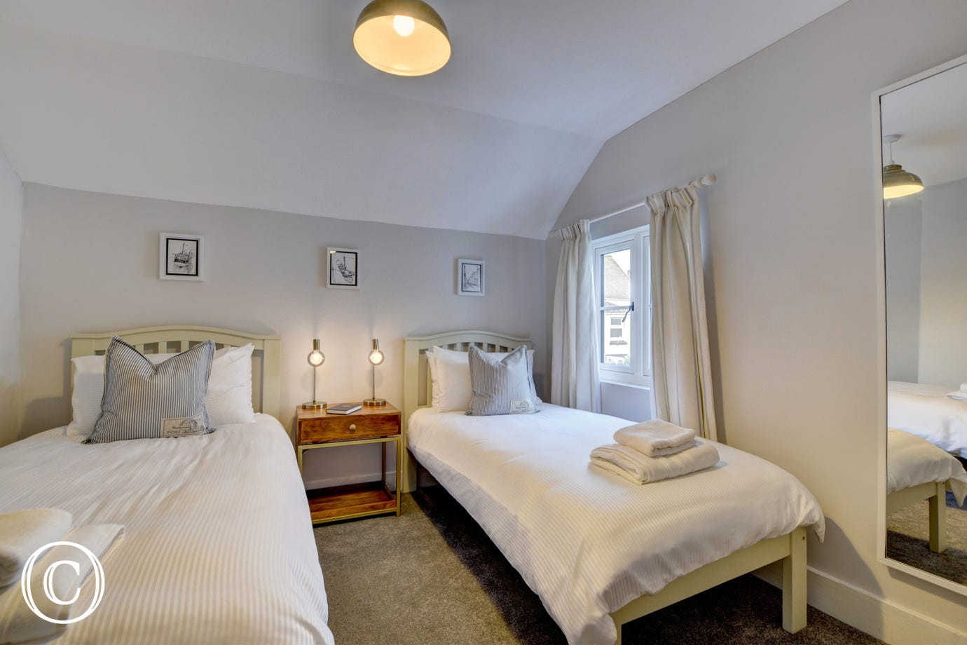 The cosy twin room is situated at the back of the property