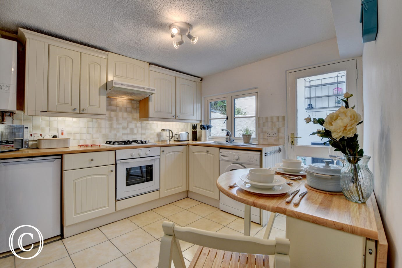 The lovely cottage style kitchen and dining room