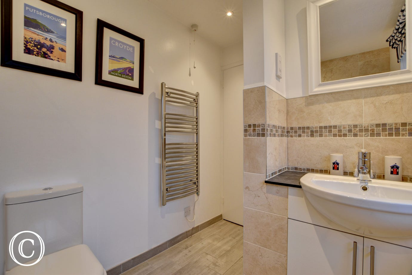 A separate modern bathroom with white suite completes the accommodation