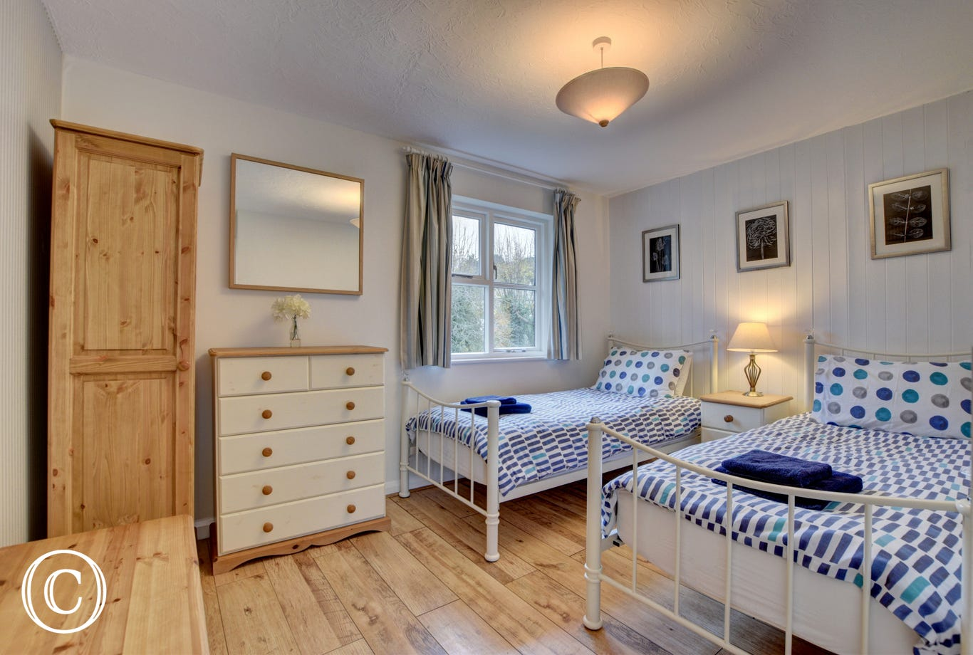 Twin bedroom with under floor heating and garden views
